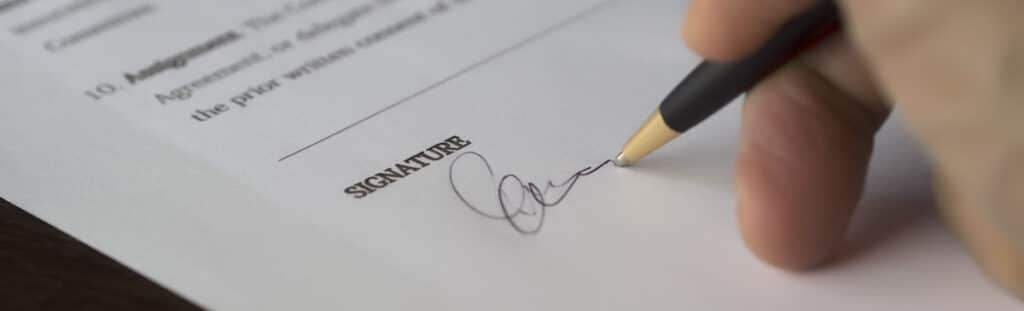 Signing a Personal Directive with a lawyer at West Legal in Calgary, Alberta