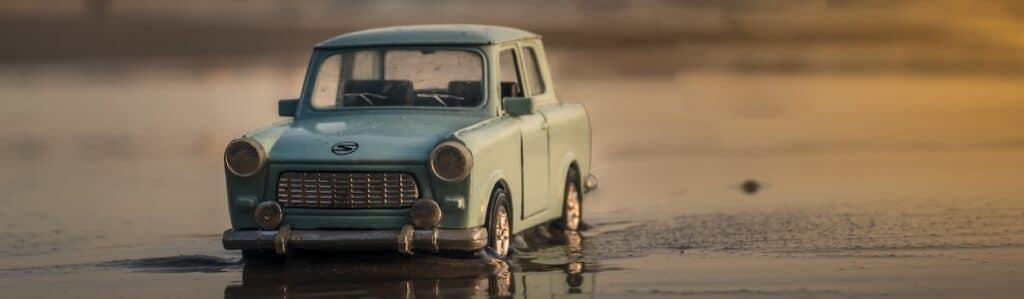 blue car on beach