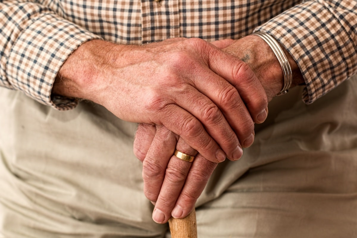 old man holding his hands together