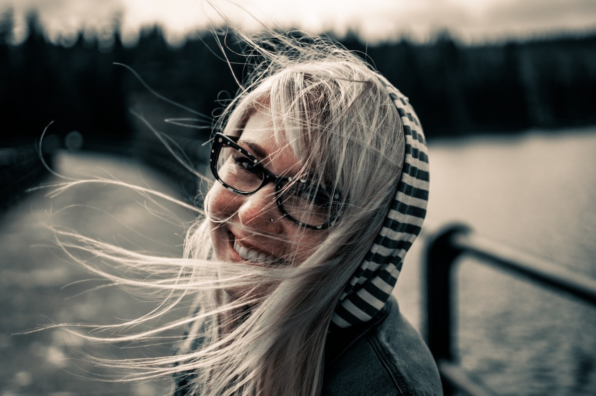 a woman smiling in glasses