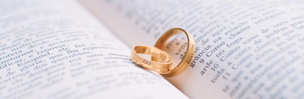 wedding rings inside a book