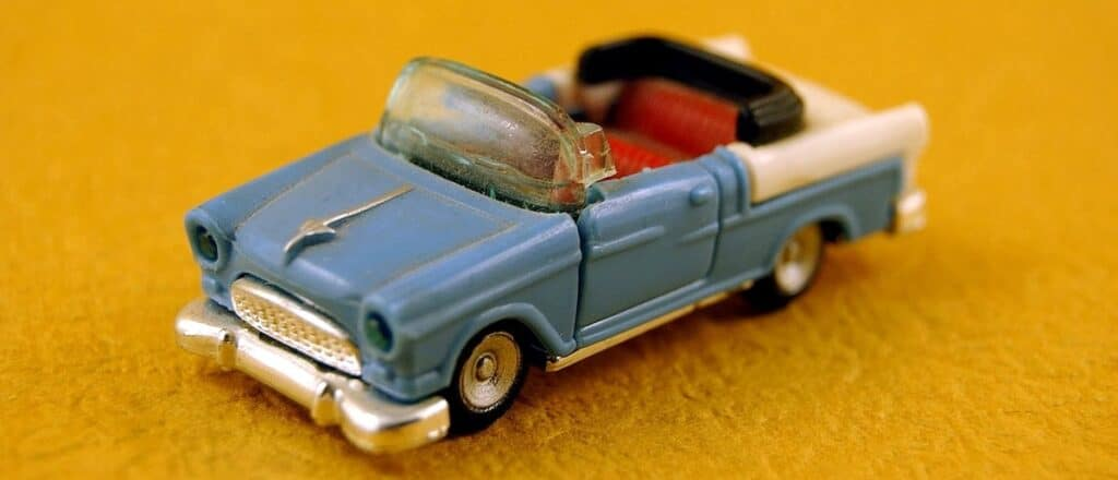 blue toy car on yellow ground