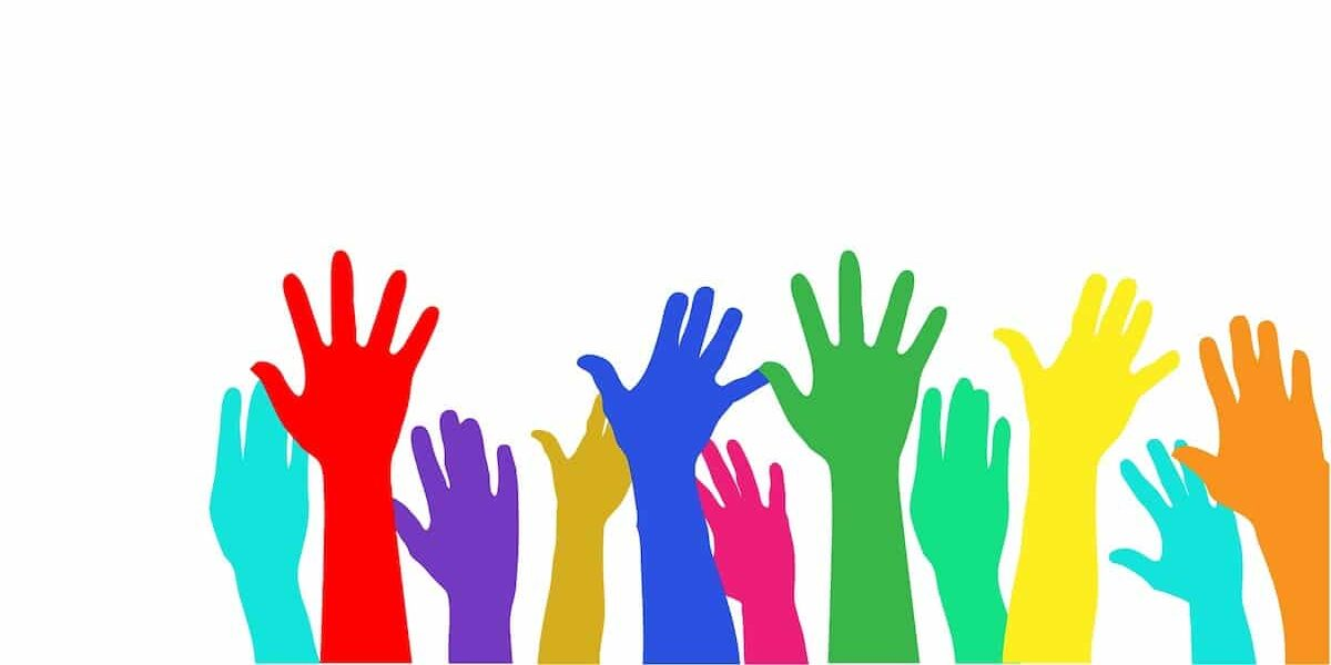various people raising their hands for human rights in Calgary, Alberta