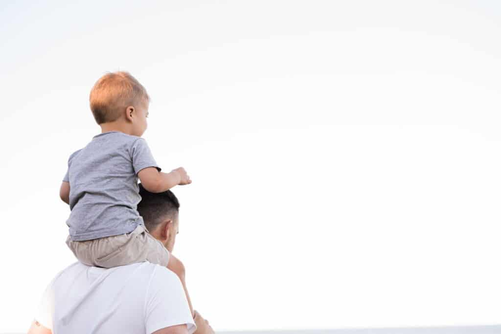child on father's back