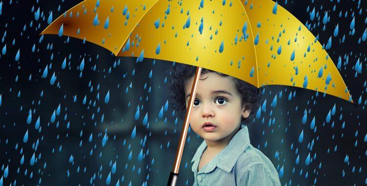 child sad under an umbrella